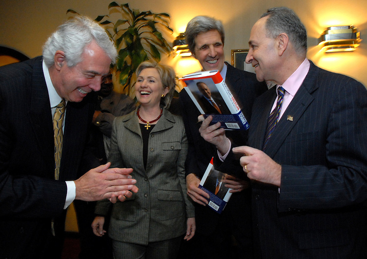 "From left, former Rep. Marty Russo, Sen. Hillary Clinton, D-N.Y., John Kerry, D-Mass., and Sen. Chuck Schumer, D-N.Y., share a laugh at a book signing reception for Schumer's new book ""Positively American"" at the Hunan Dynasty on Capitol Hill, Tuesday, January 30, 2007.  Russo and Schumer were roommates when the served in the House."