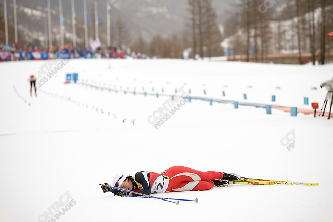 Women's 15 km cross country at Pragelato Plan during the Torino Winter Olympics. Silver medalist Marit Bjorgen of NOR.