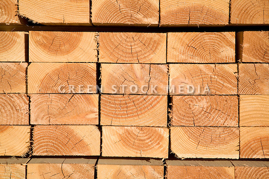 An end view of lumber showing tree ring patterns.