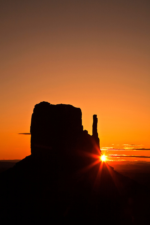 Sunburst with the Left  Mitten rock formation in Monument Valley Tribal Park, Arizona