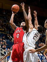 11 November 2009:  Xavier Keeling of Detroit shoots the ball over California defender during the game at Haas Pavilion in Berkeley, California.   California defeated Detroit, 95-61.
