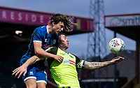 Bolton Wanderers' Daryl Murphy (right) competing with Rochdale's Luke Matheson <br /> <br /> Photographer Andrew Kearns/CameraSport<br /> <br /> The EFL Sky Bet League One - Rochdale v Bolton Wanderers - Saturday 11th January 2020 - Spotland Stadium - Rochdale<br /> <br /> World Copyright © 2020 CameraSport. All rights reserved. 43 Linden Ave. Countesthorpe. Leicester. England. LE8 5PG - Tel: +44 (0) 116 277 4147 - admin@camerasport.com - www.camerasport.com
