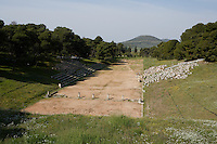EPIDAURUS, GREECE - APRIL 15 : A general view of the stadium, on April 15 2007 in Epidaurus, Greece. It forms part of the Sanctuary of Asklepios, north of the Temple of Asklepios. It was built c. 400  - 350 BC, in the Late Classical Period and only ruins remain. Asklepios was the God of health and happieness and patients came to the sanctuary in search of a cure. The stadium was part of a complex built to meet the needs of patients. (Photo by Manuel Cohen)