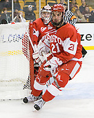 Kieran Millan (BU - 31), Sean Escobedo (BU - 21) - The Boston College Eagles defeated the Boston University Terriers 3-2 (OT) in their Beanpot opener on Monday, February 7, 2011, at TD Garden in Boston, Massachusetts.
