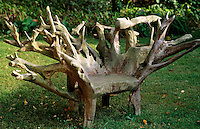The roots of an old tree have been fashioned into a rustic chair
