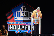 Canton, OH - August 6, 2016: Former NFL player Brett Favre gets emotional during his enshrinement speech at the Pro Football Hall of Fame Enshrinement Ceremony in Canton, Ohio, August 6, 2016, as his wife looks on.  Favre played 20 seasons in the NFL and retired as the NFL's all-time leading passer with 6,300 completions, 10,169 attempts, 71,838 yards and 508 TDs(Photo by Don Baxter/Media Images International)