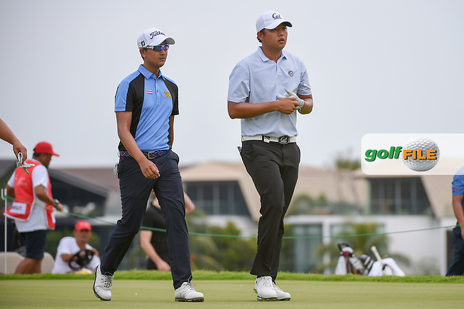 Sadom KAEWKANJANA (THA) and KK LIMBHASUT (THA) head down 18 during Rd 3 of the Asia-Pacific Amateur Championship, Sentosa Golf Club, Singapore. 10/6/2018.<br /> Picture: Golffile | Ken Murray<br /> <br /> <br /> All photo usage must carry mandatory copyright credit (© Golffile | Ken Murray)