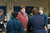 Teaching staff and engineering apprentices enjoying a laugh at Kingston College..