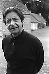 VS Naipaul outside his Oxfordshire cottage home in 1971. England... ..