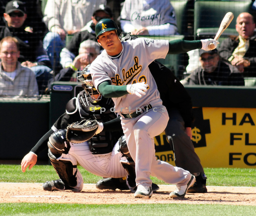 KURT SUZUKI, of the Oakland A's ,in action against the Chicago White Sox  during the A's game in Chicago, IL on April 15, 2008 The White Sox won the game 4-1.