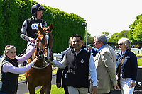 Winner of The Penang Turf Club Malaysia Novice Stakes (Plus 10 Race) (Class 4) Rumble in the jungle ridden by Tom Queally and trained by Richard Spencer is led into the winners enclosure  during Afternoon Racing at Salisbury Racecourse on 17th May 2018