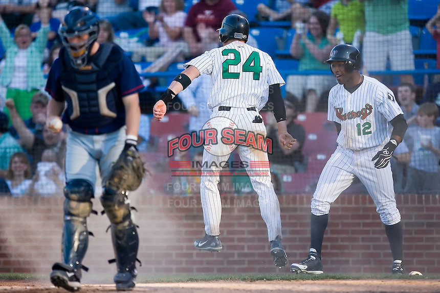 Billy Killian (24) of the Winston-Salem Warthogs celebrates with teammate John Shelby III (12) after scoring the winning run in the bottom of the 7th inning for a 4-3 win over the Kinston Indians at Ernie Shore Field in Winston-Salem, NC, Saturday, May 17, 2008.
