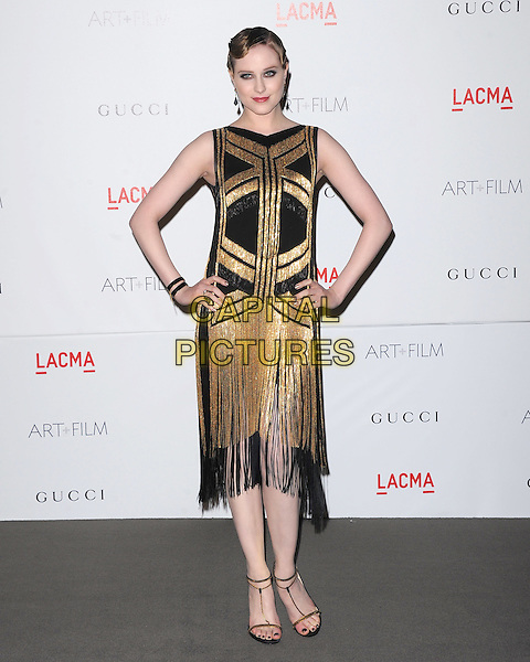 Evan Rachel Wood.The Inaugural Art and Film Gala held at LACMA in Los Angeles, California, USA..November 5th, 2011   .full length black dress sleeveless gold tassels fringed hands on hips.CAP/RKE/DVS.©DVS/RockinExposures/Capital Pictures.