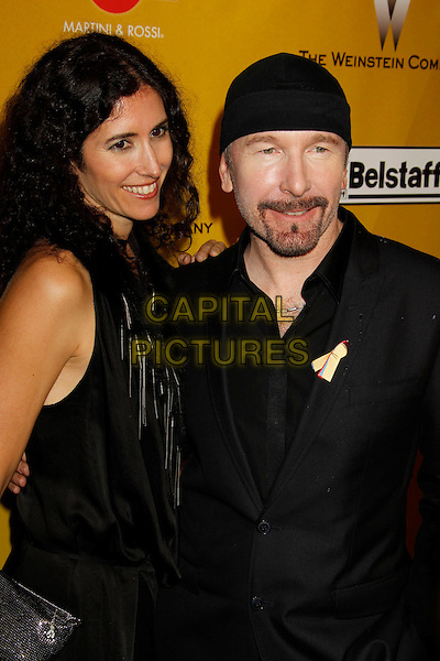 MORLEIGH STEINBERG & THE EDGE.Weinstein Company Post Golden Globe Party held at Bar210 & Plush Ultra Lounge at the Beverly Hilton Hotel, Beverly Hills, California, USA..January 17th, 2009.globes half length black suit dress   married husband wife goatee facial hair beanie hat .CAP/ADM/MJ.©Michael Jade/Admedia/Capital Pictures