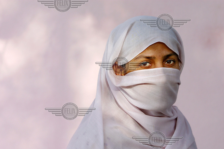 A member of the organisation RAWA (Revolutionary Association of the Women of Afghanistan) covers herself with a veil in order to remain anonymous. Kabul,Afghanistan,Asia.