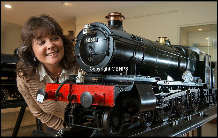 BNPS.co.uk (01202 558833)<br /> Pic: LeeMcLean/BNPS<br /> <br /> Aberporth Grange -an almost exact working model of one of the last steam trains.<br /> <br /> Full steam ahead - Incredible scale model locomotive, yours for £100,000.<br /> <br /> Two huge models of vintage steam trains have been put up for sale - for a whopping £200,000.<br /> <br /> The locomotives were hand made by legendary model builder David Aitken who paid incredible attention to detail when creating the scaled-down engines.<br /> <br /> He used original drawings based on the full size engines in order to replicate them in almost every detail.<br /> <br /> They have fully working boilers with a water and pressure gauges, safety and piston valves, lever operated firebox doors and brakes.<br /> <br /> They are being sold by auctioneers Dreweatts.