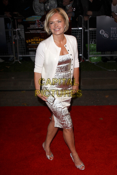 MARIELLA FROSTRUP.Premiere of 'Fantastic Mr. Fox' on the opening Gala for The Times BFI London Film Festival at the Odeon Leicester Square, London, England..October 14th, 2009.full length white cardigan gold shiny dress silver sandals clutch bag metallic strappy.CAP/AH.©Adam Houghton/Capital Pictures.