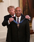 United States President Donald J. Trump presents the Presidential Medal of Freedom to former New York Yankee closer Mariano Rivera in the East Room of the White House in Washington, DC on Monday, September 16, 2019.  Rivera is a member of the Major League Baseball Hall of Fame.<br /> Credit: Ron Sachs / CNP<br /> (RESTRICTION: NO New York or New Jersey Newspapers or newspapers within a 75 mile radius of New York City)
