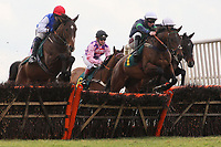 Chief Heckler ridden by Kielan Woods jumps in the lead during the European Breeders Fund National Hunt Novices Hurdle