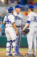 Pitching Coach Dave Schuler (21) of the Tulsa Drillers talks with Dan Houston (36) on the mound during a game against the Springfield Cardinals at Hammons Field on July 19, 2011 in Springfield, Missouri. Tulsa defeated Springfield 17-11. (David Welker / Four Seam Images)