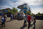 Home supporters filing out of St. Andrew's stadium and past an ice cream van, after the Birmingham City's Barclay's Premier League match with Wolverhampton Wanderers. Both clubs were battling against relegation from  England's top division. The match ended in a 1-1 draw, watched by a crowd of 26,027.