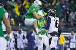 Oct 07, 2015; Eugene, OR, USA; Oregon Ducks linebacker Joe Walker (35) hugs Ducks' defensive lineman DeForest Buckner (44) after sacking California Golden Bears quarterback Jared Goff (16) at Autzen Stadium. <br /> Photo by Jaime Valdez