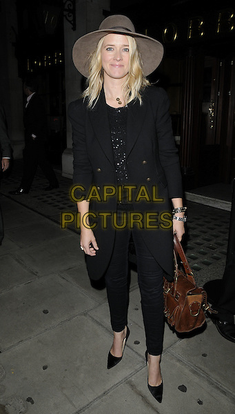 EDITH BOWMAN.At the Macmillan De'Longhi Art Auction 2010, Avenue restaurant, London, England, UK, September 28th 2010..full length black coat jeans brown bag hat floppy seventies 70's pointy Mulberry.CAP/CAN.©Can Nguyen/Capital Pictures.