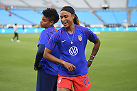 CHARLOTTE, NC - OCTOBER 03: Adrianna Franch #21 and Jessica McDonald #22 of the United States have fun prior to their game versus Korea Republic at Bank of American Stadium, on October 03, 2019 in Charlotte, NC.