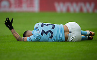 Gabriel Jesus of Manchester City holds his hand up to call for medical assistance as he lays injured with a knee problem during the Premier League match between Crystal Palace and Manchester City at Selhurst Park, London, England on 31 December 2017. Photo by Andy Rowland.
