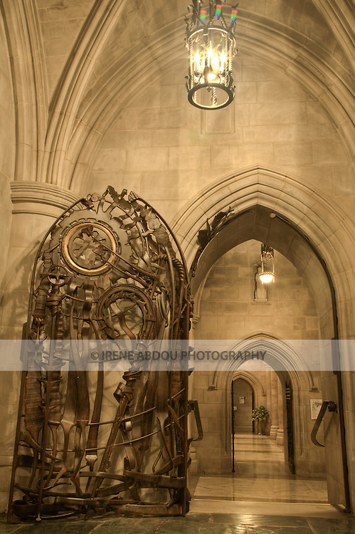Ornate carved wood door in the Washington National Cathedral in Washington, DC