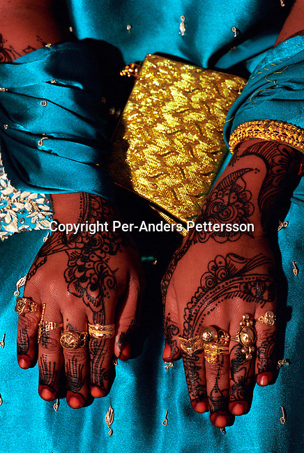 dicotanz00007 .Tanzania. An unidentified bride waiting for her husband to be in a house on October 6, 2002 in a house in Zanzibar Town on Zanzibar, Tanzania. Zanzibar is mainly Muslim and the woman is entering a traditional wedding. .©Per-Anders Pettersson/iAfrika Photos