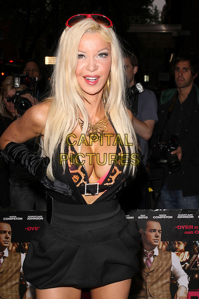 ALICIA DOUVALL.Attending UK Film Premiere of 'Pimp' at Odeon Covent Garden, London, England, May 19th 2010. .arrivals half length black dress gloves pink leopard animal print bra bikini top smiling funny hands on boobs breasts cleavage gold butterfly necklace .CAP/AH.©Adam Houghton/Capital Pictures.