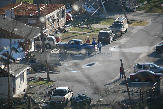 West Liberty residents who chose to stay inside the city stand near a truck. March 3, 2012. A tornado ravaged the city Friday evening. Photo by Brandon Goodwin | Staff