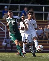 Boston College midfielder/defender Isaac Taylor (11) passes the ball as George Mason University defender Paul Andrews (4) defends. Boston College defeated George Mason University, 3-2, at Newton Soccer Field, August 26, 2011.