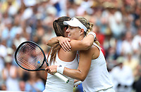 Angelique Kerber (GER) embraces opponent Daria Kasatkina (RUS) after her victory in their Ladies' Quarter Final match<br /> <br /> Photographer Rob Newell/CameraSport<br /> <br /> Wimbledon Lawn Tennis Championships - Day 8 - Tuesday 10th July 2018 -  All England Lawn Tennis and Croquet Club - Wimbledon - London - England<br /> <br /> World Copyright &not;&copy; 2017 CameraSport. All rights reserved. 43 Linden Ave. Countesthorpe. Leicester. England. LE8 5PG - Tel: +44 (0) 116 277 4147 - admin@camerasport.com - www.camerasport.com
