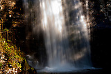 Bottom of Looking Glass Falls in mid Afternoon time, sun beam on the fall water looks bright