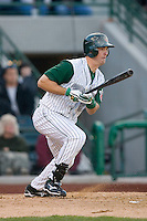 Sawyer Carroll #21 of the Fort Wayne Tin Caps follows through on his swing versus the Dayton Dragons at Parkview Field April 16, 2009 in Fort Wayne, Indiana. (Photo by Brian Westerholt / Four Seam Images)