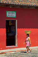 Antigua, Guatemala, October 2005. The streets in the old centre of Antigua are paved with cobblestones, lined by colonial buildings and overseen by the impressive Agua Volcano.  Guatemala is a colorful country with mix of many ancient Indian civilisations and Spanish colonial occupation. Photo by Frits Meyst/Adventure4ever.com