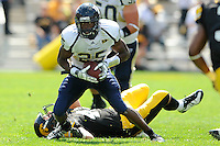 6 September 2008:  FIU defensive back Alonzo Phillips (25) evades an Iowa tackler for extra yards in the second half of the Iowa 42-0 victory over FIU at Kinnick Field in Iowa City, Iowa.