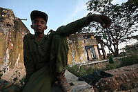 A  Somali TFG ( transitional Federal Government ) soldier holds prayer beads   in front of the entrance of an underground detention center in Baidoa, Somalia on Wednesday Dec 27 2006..
