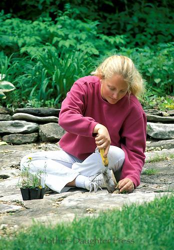 Woman planting rock garden
