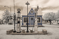 The Phillips 66 service station was located on old Route 66 near the turn off to Red Oak Missouri.  The station was brought to Red Oak II and completly restored inside and out in 1989.<br /> <br /> Red Oak II is the creation of artist Lowell Davis, who's family had pioneered the town of Red Oak.  After success as an artist, he started moving his old home town to his farm 32 miles away creating Red Oak II.  Lowell now lives in what he considers his &quot;Masterpiece&quot; in the Belle Starr house where the famous outlaw was raised.  Red Oak II is located a few miles Northeast of Carthage Missouri, just off Route 66.