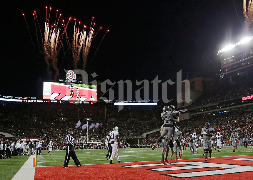 Ohio State wide receiver Johnnie Dixon (1) celebrates a 10-yard touchdown catch during the fourth quarter of the Buckeyes' 39-38 win over Penn State in the NCAA football game at Ohio Stadium in Columbus on Oct. 28, 2017. [Adam Cairns/Dispatch]