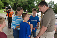 Michael McCollum<br /> 8/2/18<br /> Ryan interacts with friends and family at the reveal ceremony where it was announced to 13 year old Ryan Overman of west Knoxville that The Wish Connection is granting Ryan&rsquo;s wish to go to Washington DC and visit the White House at Carl Cowan Park, 10058 S Northshore Dr, Knoxville, TN&nbsp;, Thursday, August 2, 2018 at 5:45pm. Approximately 50-60 people attended, including the Overman family, friends, and AT&amp;T Employees. The Bearden High School Cadets also attended and lead the pledge of allegiance.<br /> &nbsp;The AT&amp;T Wish Connection is going to send Ryan, his family, and his service dog to Washington DC and while they are gone, the group of volunteers will be doing a makeover on his bedroom and turn it into the &quot;Oval Office&quot; at the White House.<br /> Ryan was born two weeks prematurely on May 13, 2005.&nbsp; During the pregnancy he was classified as high risk due to a measured lack of growth and, after a brief stay in the hospital, he came home weighing only 4 lbs 5 oz.&nbsp; His development was much slower compared to his peers, such as not learning to walk until he was well over a year old, and he was much smaller. The Overman family worked with Tennessee Early Intervention Services (TEIS) when Ryan was about one year old and with their help they were able to get Ryan enrolled through TEIS to receive Occupational, Physical, and Speech Therapy.&nbsp; When Ryan turned three he transitioned from TEIS to the Knox County Early Intervention Program and began attending a special school to continue his therapies until he was old enough to enroll at Cedar Bluff Elementary and now is at Cedar Bluff Middle School. In 2016, Ryan was diagnosed to have retinitis pigmentosa, a degenerative disease of the retinas that under the best of circumstances causes severe tunnel vision, but more commonly results in complete blindness.<br /> &nbsp;Despite the physical difficulties that Ryan has had to endure over the last thirteen years, he continually brightens the lives of those around him.&nbsp; If some