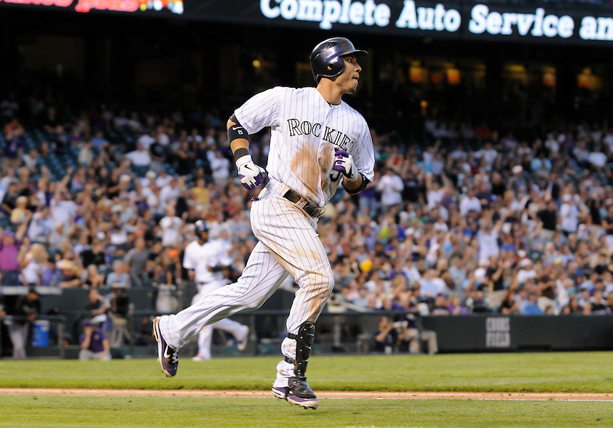 17 AUGUST 2011: Colorado Rockies left fielder Carlos Gonzalez (5) watches the flight of a three run homerun    during a regular season game between the Florida Marlins and the Colorado Rockies at Coors Field in Denver, Colorado. The Rockies beat the Marlins 12-5. *****For Editorial Use Only*****