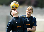 St Johnstone Training&hellip;24.08.18<br />Matty Kennedy showing off his ball control to Liam Craig during training this morning at McDiarmid Park ahead of tomorrow&rsquo;s game against Dundee<br />Picture by Graeme Hart.<br />Copyright Perthshire Picture Agency<br />Tel: 01738 623350  Mobile: 07990 594431
