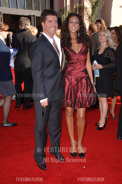 SIMON COWELL & girlfriend TERRY SEYMOUR at the 2006 Primetime Emmy Awards at the Shrine Auditorium, Los Angeles..8 27, 2006 Los Angeles, CA.© 2006 Paul Smith / Featureflash