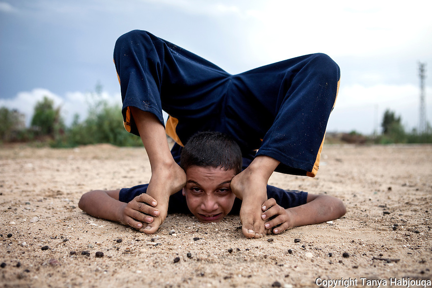 Gaza youth shows off his yogi moves.