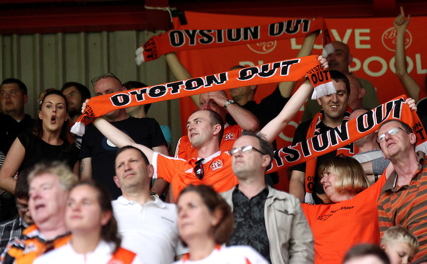 Blackpool fans protest against their clubs owner Carl Oyston during the second half<br /> <br /> Photographer Rich Linley/CameraSport<br /> <br /> Football - The Football League Sky Bet League One - Sheffield United v Blackpool - Saturday 22nd August 2015 - Bramall Lane - Sheffield<br /> <br /> &copy; CameraSport - 43 Linden Ave. Countesthorpe. Leicester. England. LE8 5PG - Tel: +44 (0) 116 277 4147 - admin@camerasport.com - www.camerasport.com