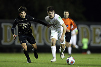 WINSTON-SALEM, NC - DECEMBER 01: Nebojsa Popovic #33 of the University of Michigan is chased by Nico Belancazar #23 of Wake Forest University during a game between Michigan and Wake Forest at W. Dennie Spry Stadium on December 01, 2019 in Winston-Salem, North Carolina.